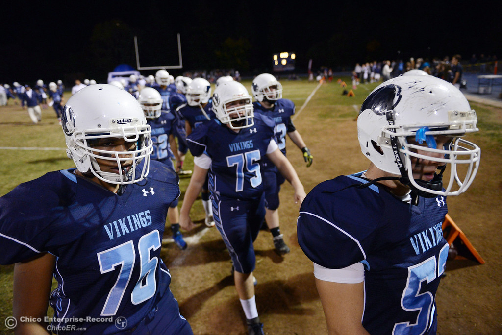 . Pleasant Valley High\'s #76 Bailey Wasden (left) and #52 Cristian Miranda (right) take the field against Shasta High before the first quarter of their football game at PVHS Asgard Yard Friday, October 18, 2013 in Chico, Calif.  (Jason Halley/Chico Enterprise-Record)