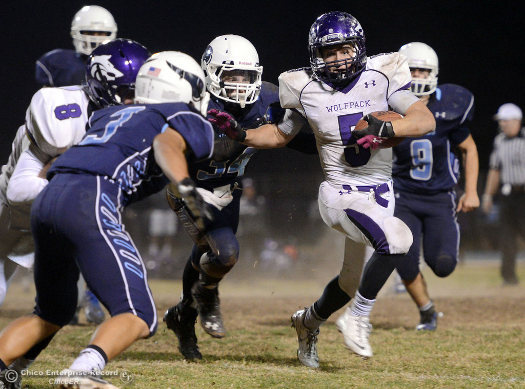 . Pleasant Valley High against Shasta High\'s #5 Jake Callaway (right) in the fourth quarter of their football game at PVHS Asgard Yard Friday, October 18, 2013 in Chico, Calif.  (Jason Halley/Chico Enterprise-Record)