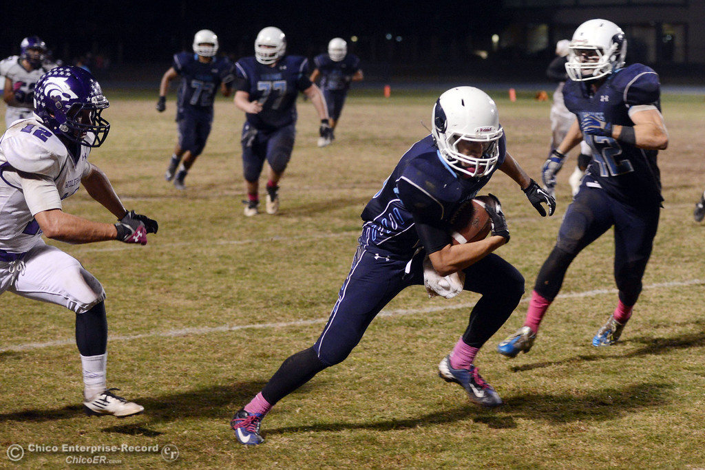 . Pleasant Valley High\'s #16 Trey Rosenbalm (center) rushes against Shasta High in the fourth quarter of their football game at PVHS Asgard Yard Friday, October 18, 2013 in Chico, Calif.  (Jason Halley/Chico Enterprise-Record)
