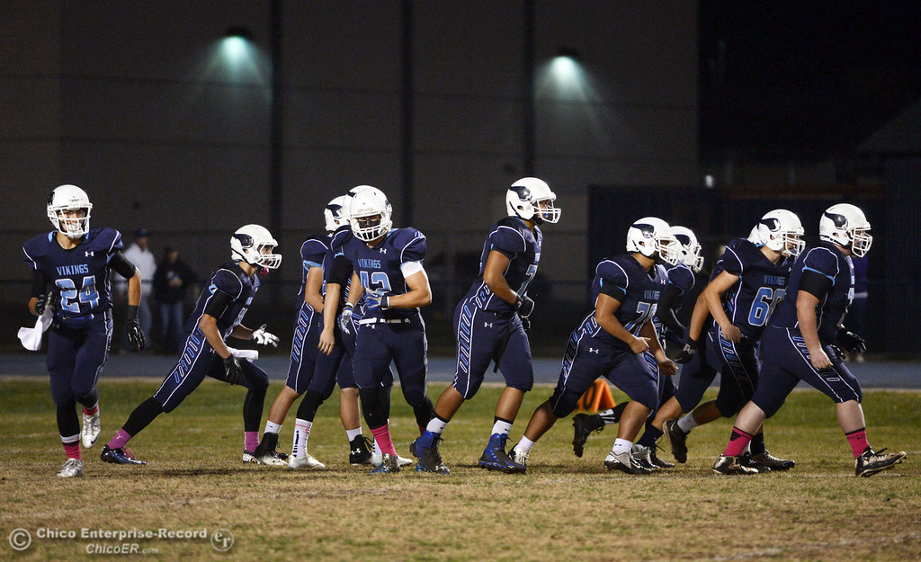 . Pleasant Valley High offense takes the line against Shasta High in the first quarter of their football game at PVHS Asgard Yard Friday, October 18, 2013 in Chico, Calif.  (Jason Halley/Chico Enterprise-Record)