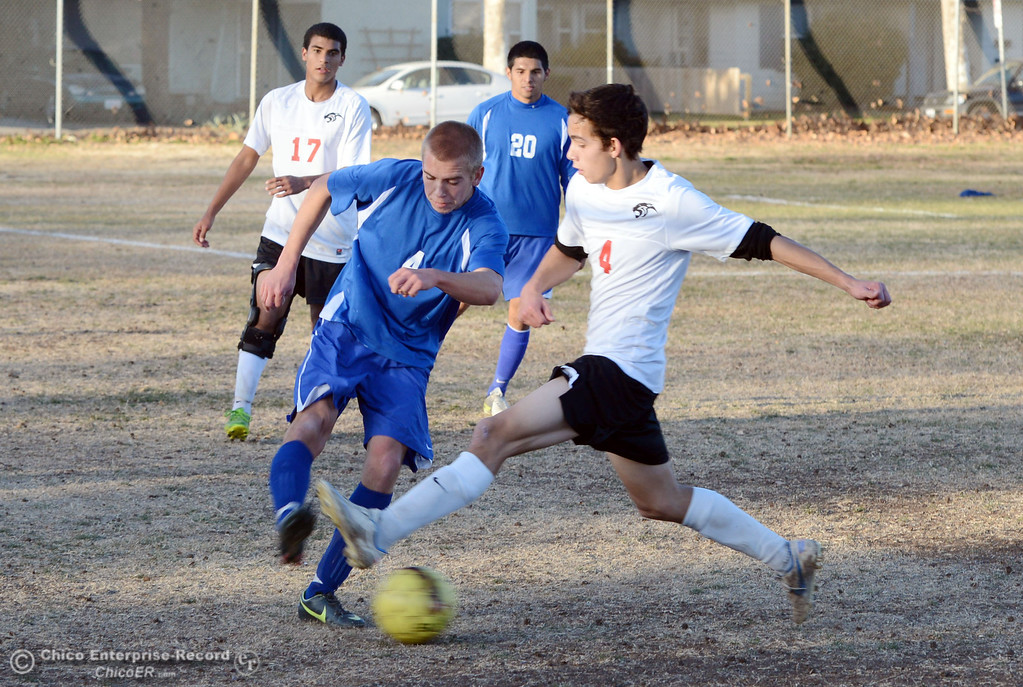 . Chico High\'s #4 Jack Chinchay (right) against Orland High\'s #4 Devin James (left) in the first half of their boys soccer game at CHS Thursday, December 19, 2013 in Chico, Calif. (Jason Halley/Chico Enterprise-Record)