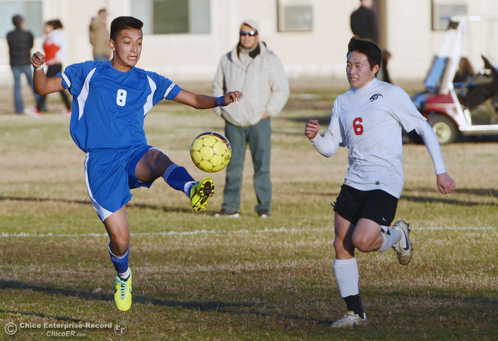 . Chico High\'s #6 Kee Lor (right) against Orland High\'s #8 Israel Zintzun (left) in the first half of their boys soccer game at CHS Thursday, December 19, 2013 in Chico, Calif. (Jason Halley/Chico Enterprise-Record)