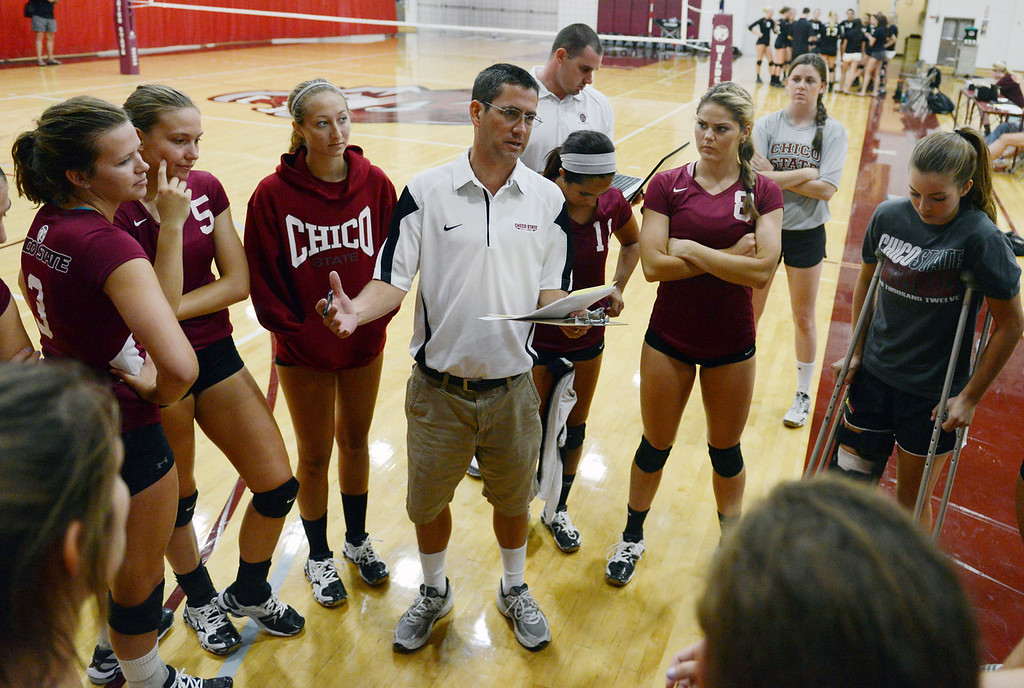 . Chico State coach Cody Hein (center) talks to the team against Butte College in their volleyball game at CSUC Acker Gym Saturday, August 24, 2013 in Chico, Calif.  (Jason Halley/Chico Enterprise-Record)
