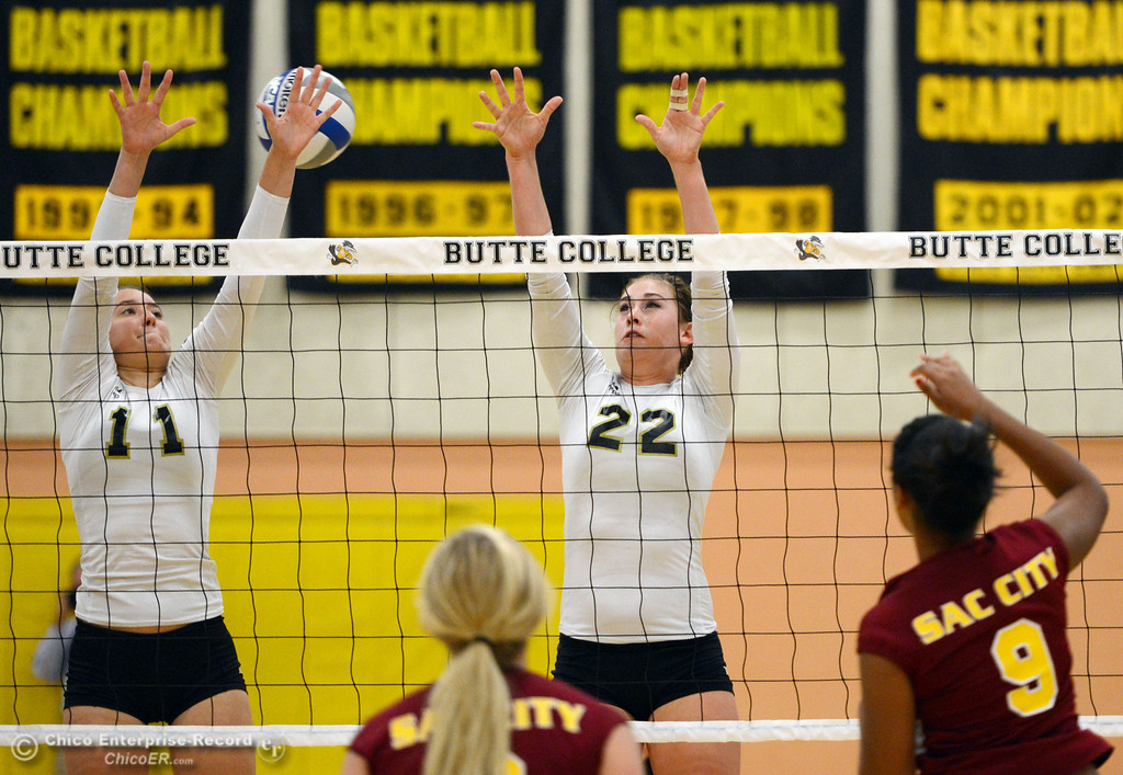 . Butte College\'s #11 Brooke Silverman (left) and #22 Courtney Robinson (center) attempt to block against Sac City College\' #9 Elliza North (right) in the first game of their women\'s volleyball match at Butte\'s Cowan Gym Wednesday, September 25, 2013, in Oroville, Calif.  (Jason Halley/Chico Enterprise-Record)