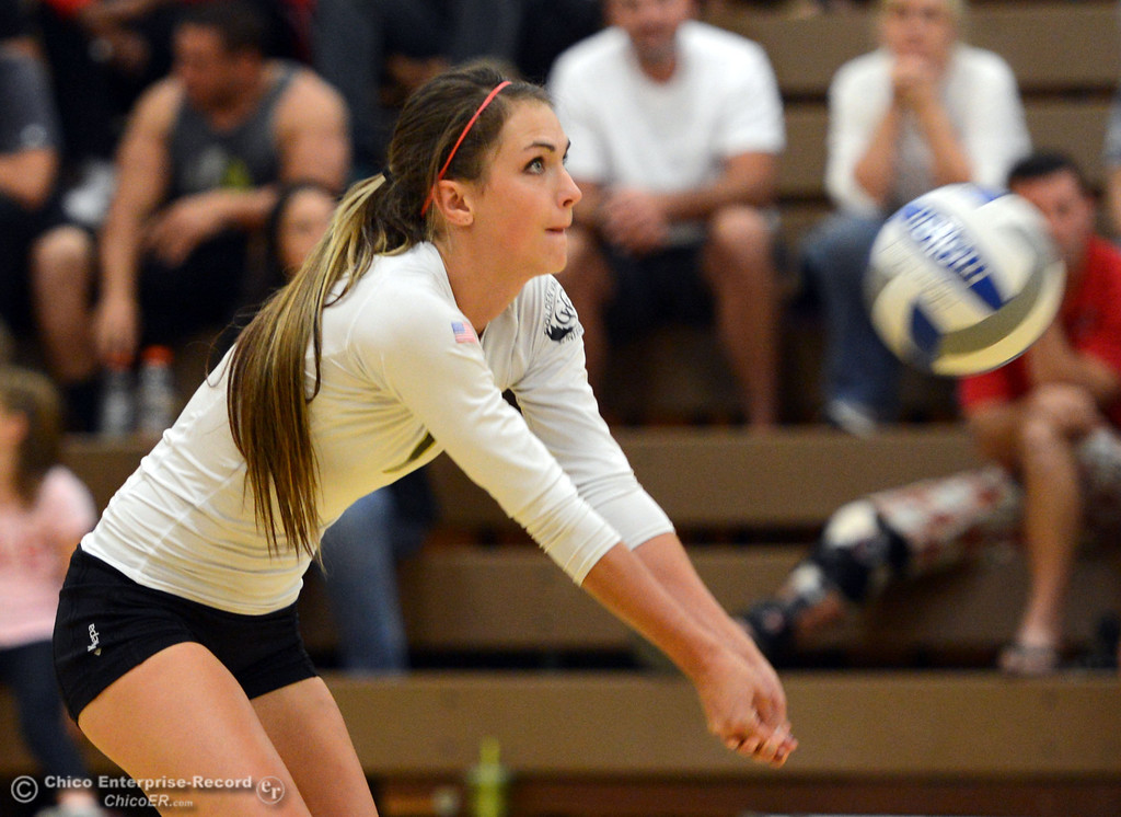 . Butte College\'s #7 Taylor Johnson takes a dig against Sac City College in the first game of their women\'s volleyball match at Butte\'s Cowan Gym Wednesday, September 25, 2013, in Oroville, Calif.  (Jason Halley/Chico Enterprise-Record)