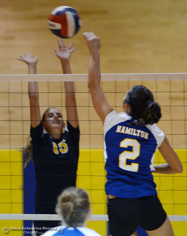 . Hamilton High\'s #2 Raegan Avrit (right) spikes against Gridley High\'s #15 Kaelin Rice (left) in their second game of their volleyball match Thursday, August 29, 2013 in Chico, Calif.  (Jason Halley/Chico Enterprise-Record)