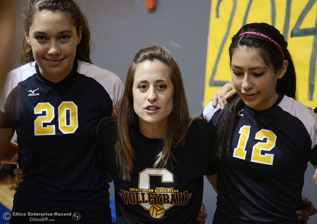 . Gridley High\'s head coach Sarah Tamagni (center) and team warms up against Hamilton High before their first game of their volleyball match Thursday, August 29, 2013 in Chico, Calif.  (Jason Halley/Chico Enterprise-Record)