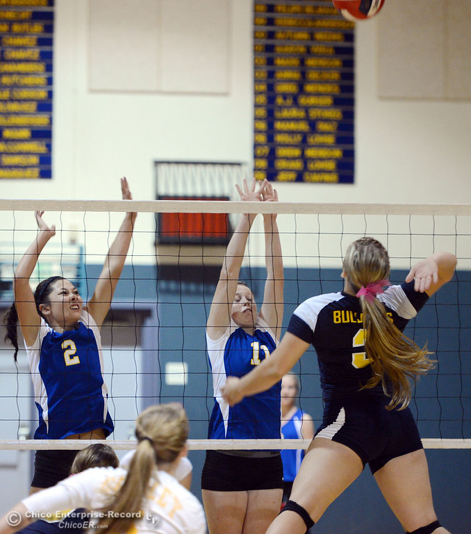 . Hamilton High\'s #2 Raegan Avrit (left) and #11 Jamie Engel (center) attempt to block against Gridley High\'s #3 Megan Anthony (right) in their first game of their volleyball match Thursday, August 29, 2013 in Chico, Calif.  (Jason Halley/Chico Enterprise-Record)