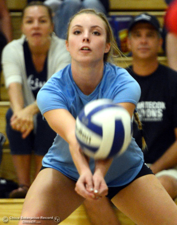 . Pleasant Valley High\'s #10 Ashley Geiger digs the ball against Chico High in the first game of their girls volleyball match at PVHS Varley Gym Saturday, October 12, 2013 in Chico, Calif.  (Jason Halley/Chico Enterprise-Record)