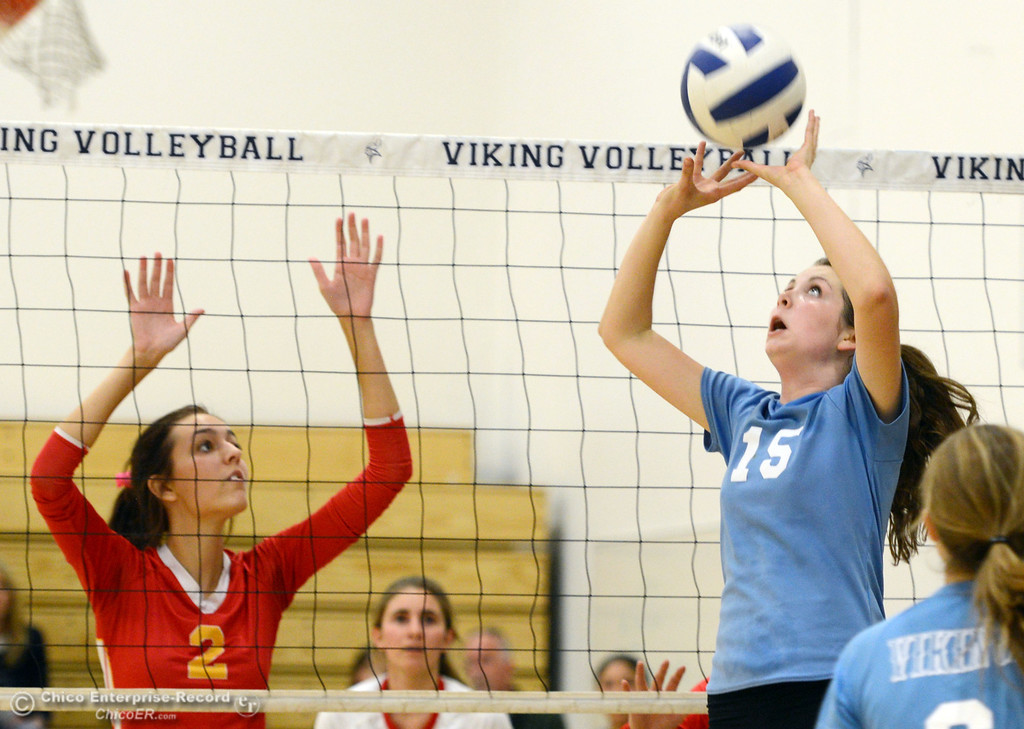 . Pleasant Valley High\'s #15 Sydney Stanley (right) sets against Chico High\'s #2 Sydney Gaskey (left) in the second game of their girls volleyball match at PVHS Varley Gym Saturday, October 12, 2013 in Chico, Calif.  (Jason Halley/Chico Enterprise-Record)