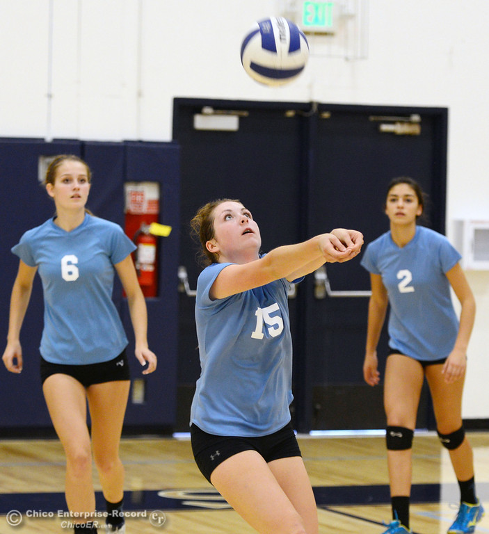 . Pleasant Valley High\'s #15 Sydney Stanley (center) bumps the ball against Chico High in the second game of their girls volleyball match at PVHS Varley Gym Saturday, October 12, 2013 in Chico, Calif.  (Jason Halley/Chico Enterprise-Record)
