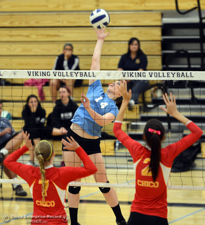 . Pleasant Valley High\'s #14 Courtney Holloway (center) spikes the ball against Chico High\'s #7 Allysa Barrett (left) and #2 Sydney Gaskey (right) in the first game of their girls volleyball match at PVHS Varley Gym Saturday, October 12, 2013 in Chico, Calif.  (Jason Halley/Chico Enterprise-Record)