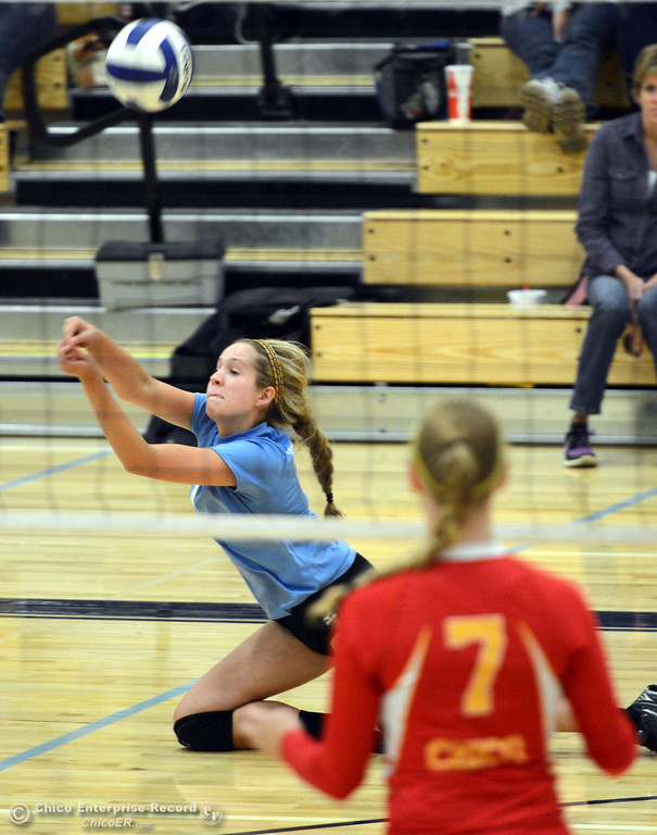 . Pleasant Valley High\'s #7 Meagan Mason digs for the ball against Chico High in the first game of their girls volleyball match at PVHS Varley Gym Saturday, October 12, 2013 in Chico, Calif.  (Jason Halley/Chico Enterprise-Record)