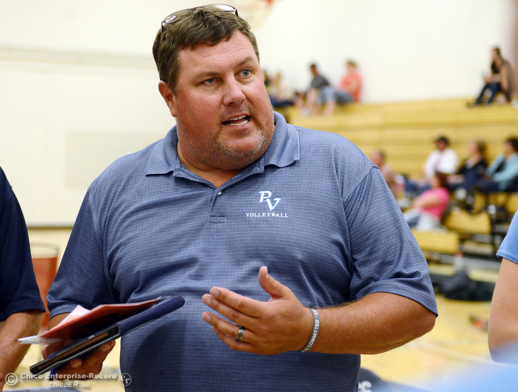 . Pleasant Valley High coach John Mitchell (center) talks to the team against Chico High in the first game of their girls volleyball match at PVHS Varley Gym Saturday, October 12, 2013 in Chico, Calif.  (Jason Halley/Chico Enterprise-Record)
