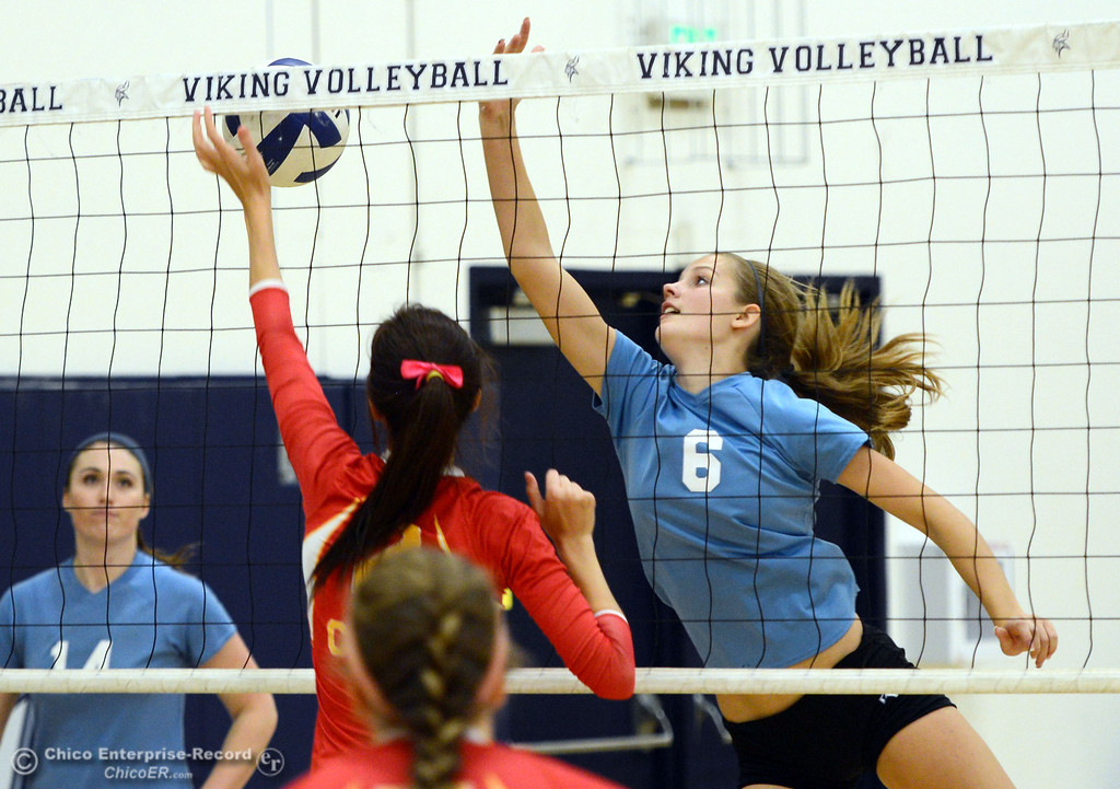 . Pleasant Valley High\'s #6 Hanne Henriksen (right) attempts to hit the ball against Chico High in the second game of their girls volleyball match at PVHS Varley Gym Saturday, October 12, 2013 in Chico, Calif.  (Jason Halley/Chico Enterprise-Record)