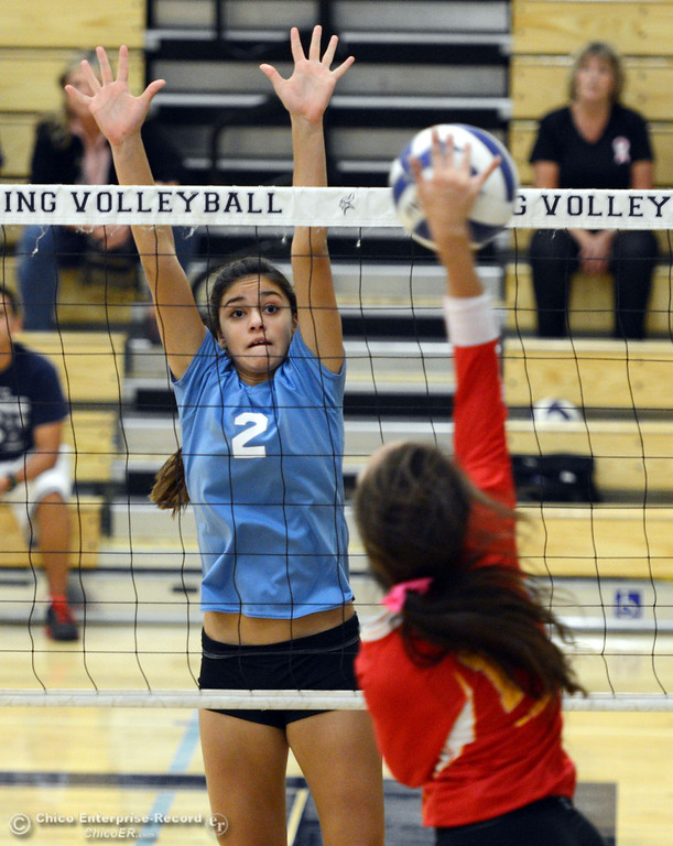 . Pleasant Valley High\'s #2 Lily Justine (left) goes up to block against Chico High\'s #13 Becca Korte (right) in the first game of their girls volleyball match at PVHS Varley Gym Saturday, October 12, 2013 in Chico, Calif.  (Jason Halley/Chico Enterprise-Record)