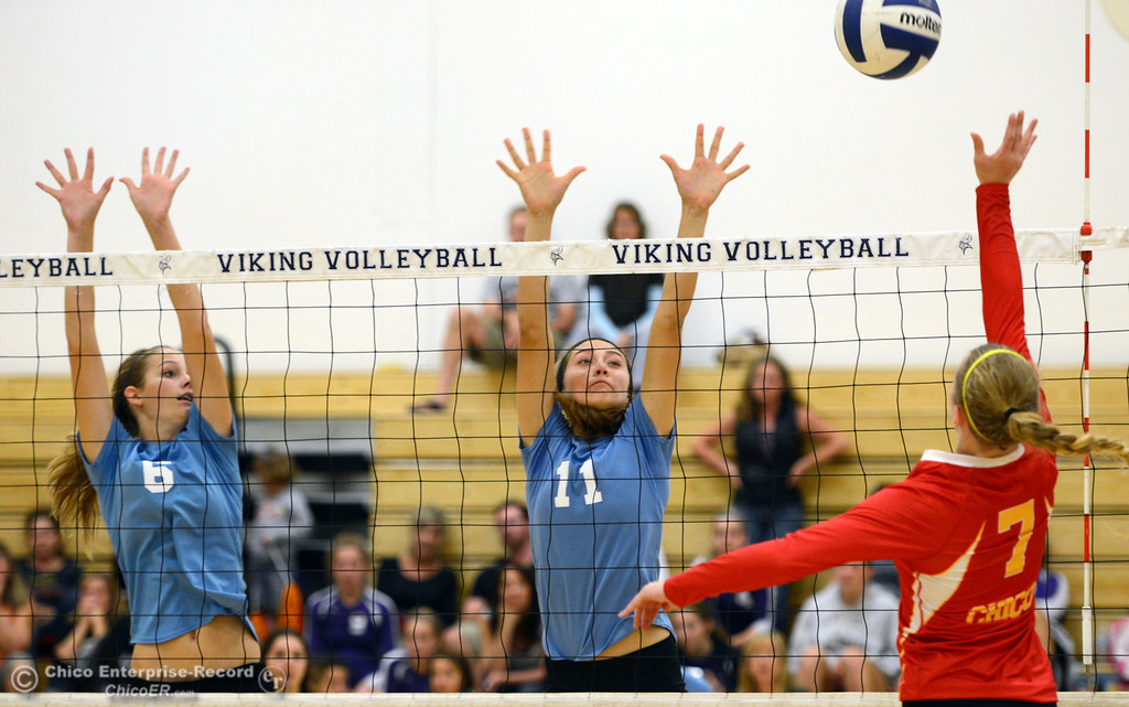 . Pleasant Valley High\'s #6 Hanne Henriksen (left) and #11 Heather Pemebroke (center) block against Chico High\'s #7 Allysa Barrett (right) in the second game of their girls volleyball match at PVHS Varley Gym Saturday, October 12, 2013 in Chico, Calif.  (Jason Halley/Chico Enterprise-Record)