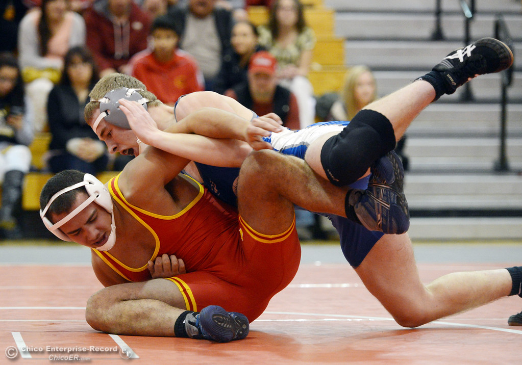 . Chico High\'s John Leal (left) wrestles against Orland High\'s Lane Williams (right) in the 170 lbs wrestling match at CHS Wednesday, December 18, 2013 in Chico, Calif. (Jason Halley/Chico Enterprise-Record)