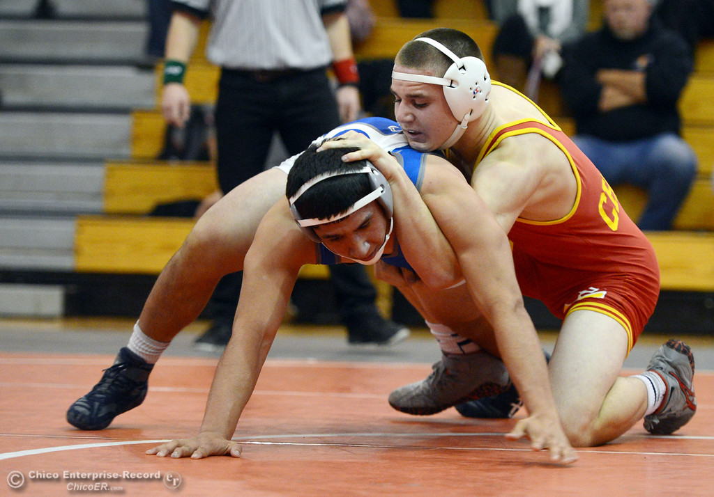 . Chico High\'s Nicholas Maximov (right) wrestles against Orland High\'s Omar Ortega (left) in the 182 lbs wrestling match at CHS Wednesday, December 18, 2013 in Chico, Calif. (Jason Halley/Chico Enterprise-Record)