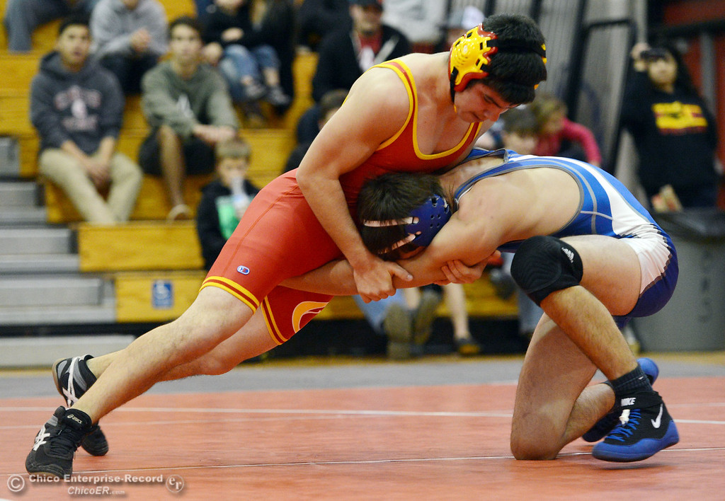 . Chico High\'s Emiliano Chavez (left) wrestles against Orland High\'s Steven Abbott (right) in the 152 lbs wrestling match at CHS Wednesday, December 18, 2013 in Chico, Calif. (Jason Halley/Chico Enterprise-Record)
