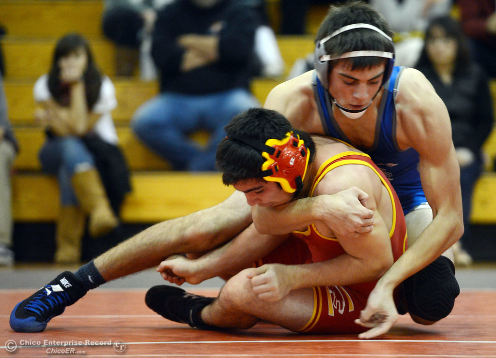. Chico High\'s Emiliano Chavez (bottom) wrestles against Orland High\'s Steven Abbott (top) in the 152 lbs wrestling match at CHS Wednesday, December 18, 2013 in Chico, Calif. (Jason Halley/Chico Enterprise-Record)
