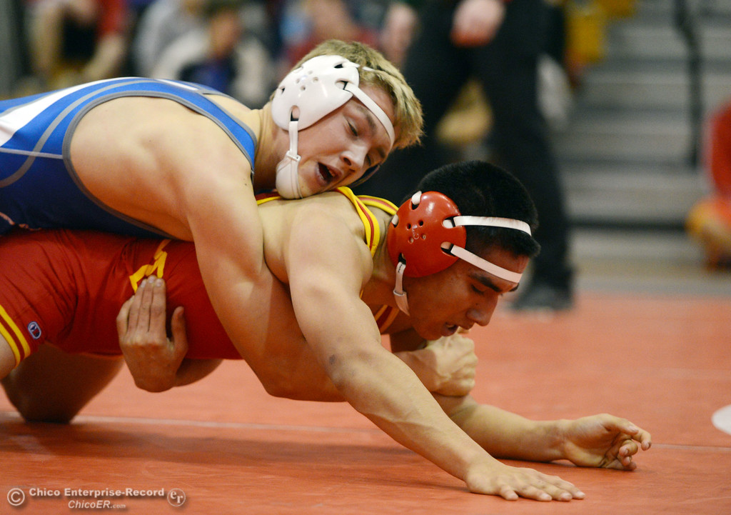 . Chico High\'s David Leyva (right) wrestles against Orland High\'s Quinton Hill (left) in the 145 lbs wrestling match at CHS Wednesday, December 18, 2013 in Chico, Calif. (Jason Halley/Chico Enterprise-Record)
