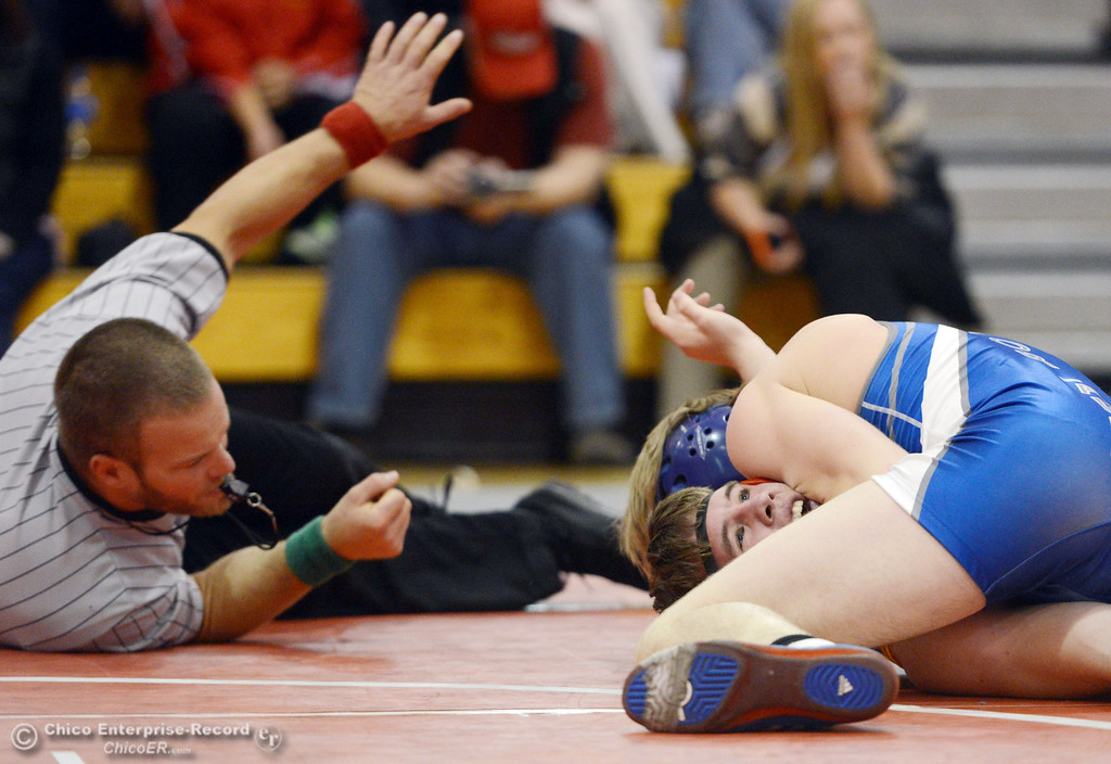 . Chico High\'s Graham Kearns (bottom) wrestles against Orland High\'s Dallas Deatherage (top) in the 160 lbs wrestling match at CHS Wednesday, December 18, 2013 in Chico, Calif. (Jason Halley/Chico Enterprise-Record)