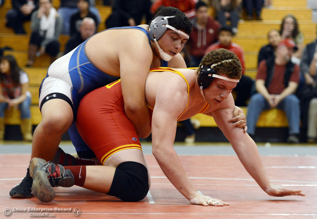 . Chico High\'s Malik Hopkins (right) wrestles against Orland High\'s Carlos Gomez (left) in the 285 lbs wrestling match at CHS Wednesday, December 18, 2013 in Chico, Calif. (Jason Halley/Chico Enterprise-Record)