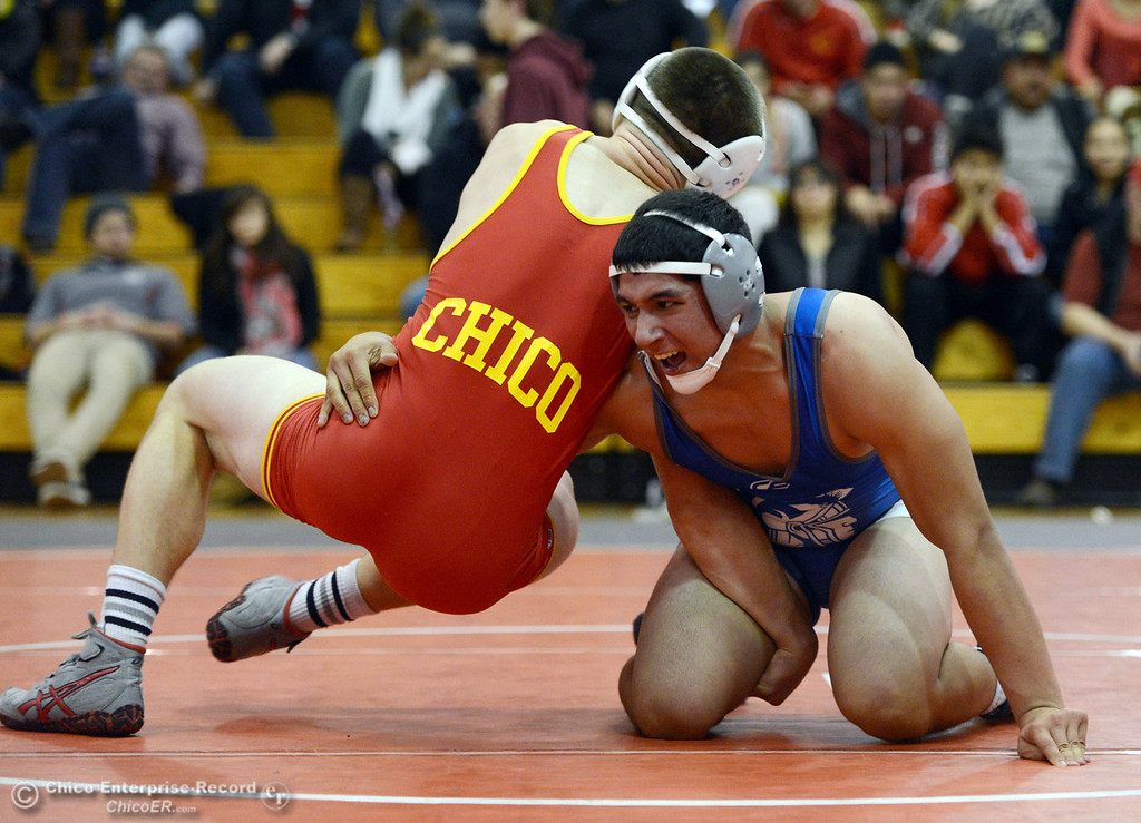 . Chico High\'s Nicholas Maximov (left) wrestles against Orland High\'s Omar Ortega (right) in the 182 lbs wrestling match at CHS Wednesday, December 18, 2013 in Chico, Calif. (Jason Halley/Chico Enterprise-Record)