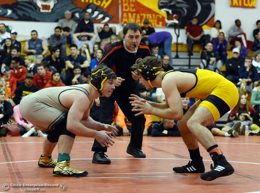 . Paradise High\'s Wyatt Wyckoff (left) wrestles against Del Oro High\'s Dustin Edwards (right) in their 145 lbs match at the Joe Rios Memorial Wrestling Tournament at CHS Saturday, January 4, 2014 in Chico, Calif.  (Jason Halley/Chico Enterprise-Record)
