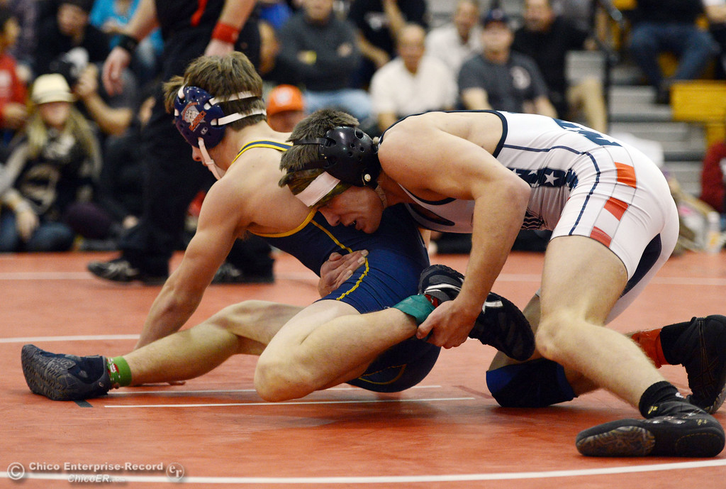 . Las Plumas High\'s Lake Gee (right) wrestles against Henley High\'s Cooper Noonan (left) in their 138lbs match at the Joe Rios Memorial Wrestling Tournament at CHS Saturday, January 4, 2014 in Chico, Calif.  (Jason Halley/Chico Enterprise-Record)