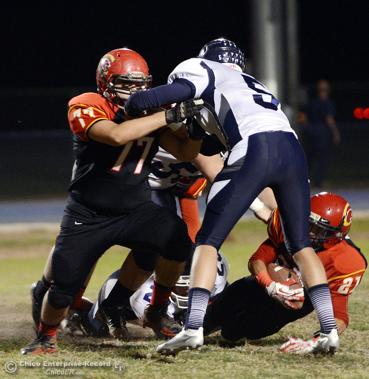 . Chico High\'s #77 Brandon Zepeda (left) blocks against Central Valley High\'s #5 Kolton Naylor (right) in the first quarter of their football game at Asgard Yard Friday, September 27, 2013, in Chico, Calif.  (Jason Halley/Chico Enterprise-Record)