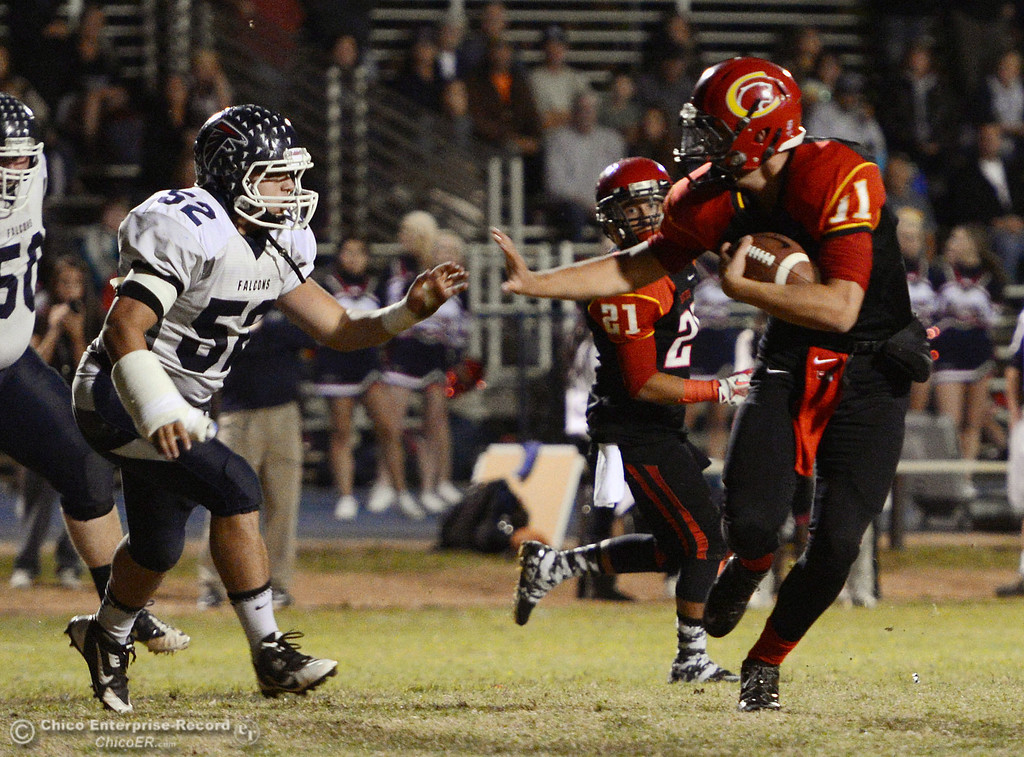 . Chico High\'s #11 Clayton Welch (right) rushes against Central Valley High\'s #52 Ernesto Alvarez (left) in the first quarter of their football game at Asgard Yard Friday, September 27, 2013, in Chico, Calif.  (Jason Halley/Chico Enterprise-Record)