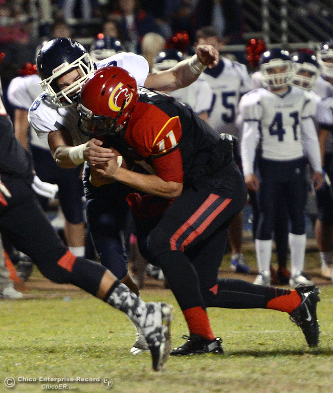 . Chico High\'s #11 Clayton Welch (center) is tackled against Central Valley High\'s #6 Connor Silveria (back) in the first quarter of their football game at Asgard Yard Friday, September 27, 2013, in Chico, Calif.  (Jason Halley/Chico Enterprise-Record)