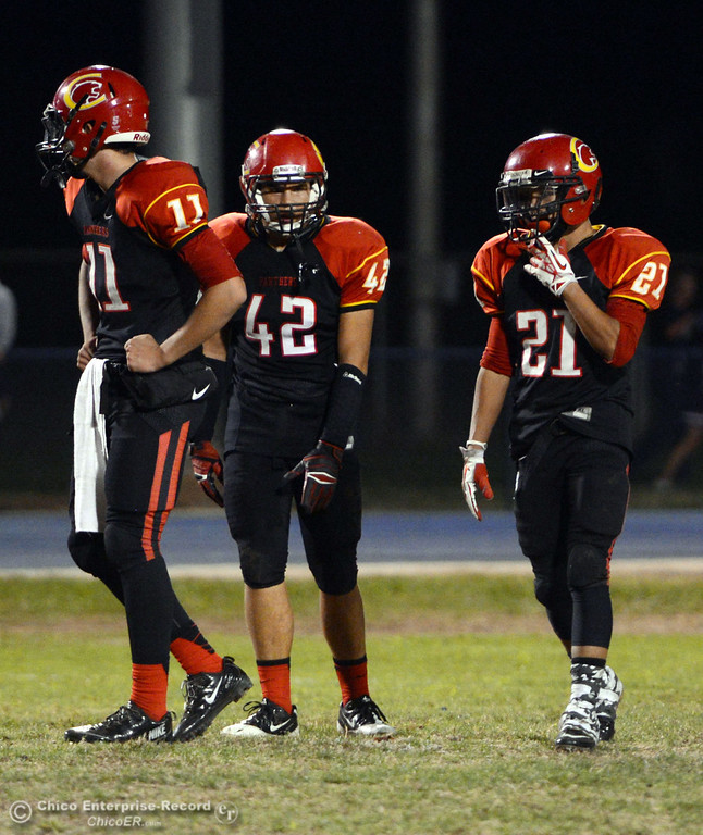 . Chico High\'s #11 Clayton Welch (left) #42 Nate Guanzon (center), and #21 Cameron Alfaro (right) against Central Valley High in the first quarter of their football game at Asgard Yard Friday, September 27, 2013, in Chico, Calif.  (Jason Halley/Chico Enterprise-Record)