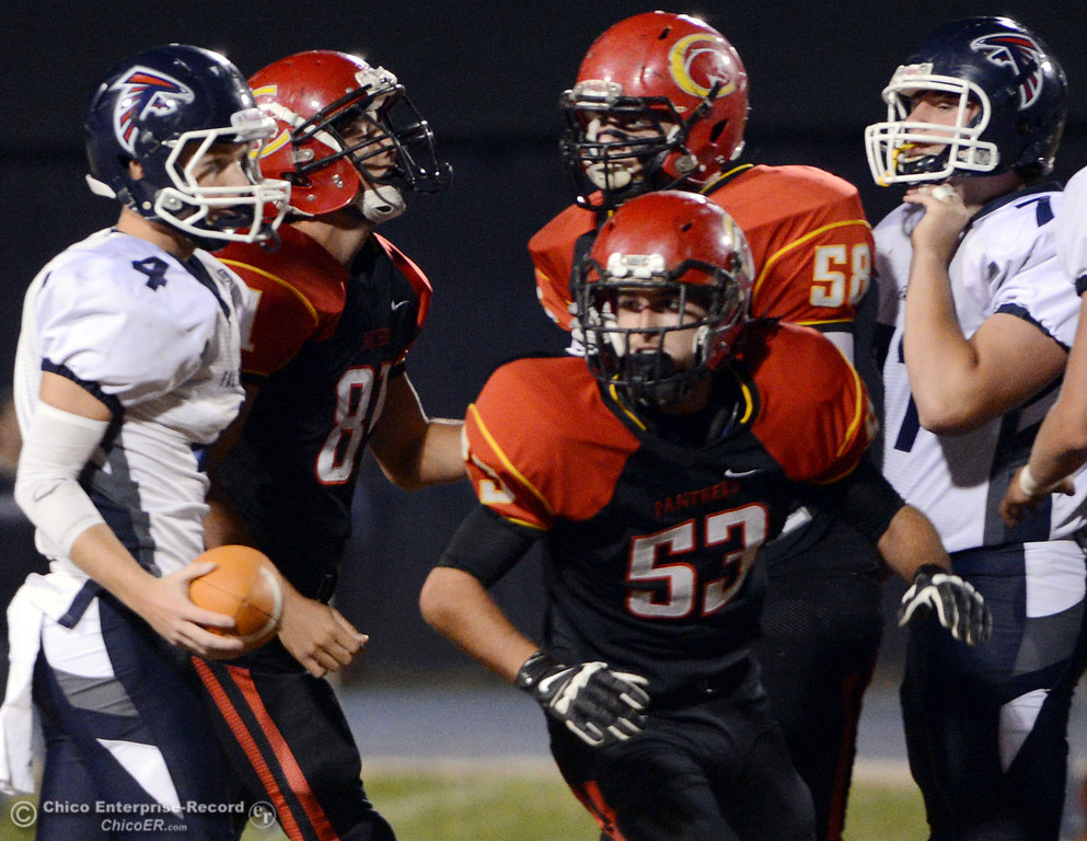 . Chico High\'s #53 Cameron Power (right) against Central Valley High in the first quarter of their football game at Asgard Yard Friday, September 27, 2013, in Chico, Calif.  (Jason Halley/Chico Enterprise-Record)