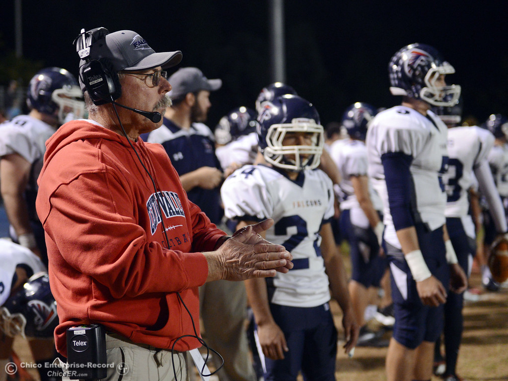 . Central Valley High Coach Matt Hunsaker looks on against Chico High in the first quarter of their football game at Asgard Yard Friday, September 27, 2013, in Chico, Calif.  (Jason Halley/Chico Enterprise-Record)
