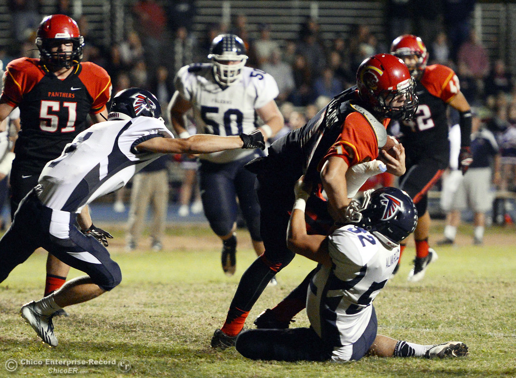 . Chico High\'s #11 Clayton Welch (center) is tackled against Central Valley High\'s #52 Ernesto Alvarez (right) and #7 James Quinn (left) in the first quarter of their football game at Asgard Yard Friday, September 27, 2013, in Chico, Calif.  (Jason Halley/Chico Enterprise-Record)