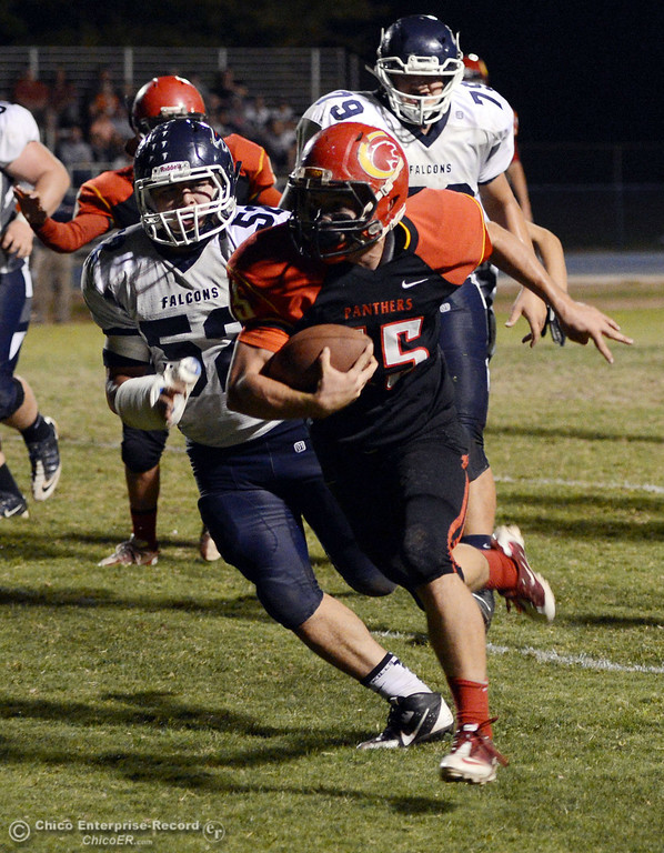. Chico High\'s #15 Miles Fishback (right) rushes for a touchdown against Central Valley High\'s #52 Ernesto Alvarez (left) in the first quarter of their football game at Asgard Yard Friday, September 27, 2013, in Chico, Calif.  (Jason Halley/Chico Enterprise-Record)